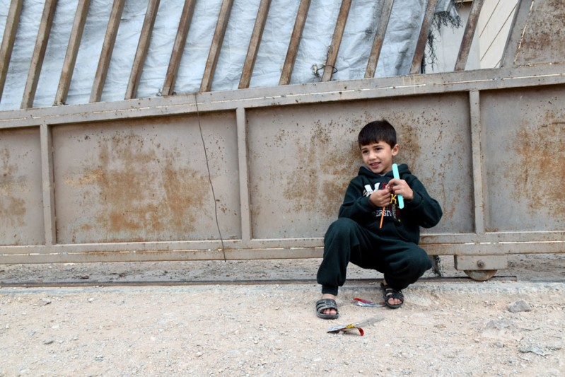 4. Abdullah, 5, plays outside the family home_min