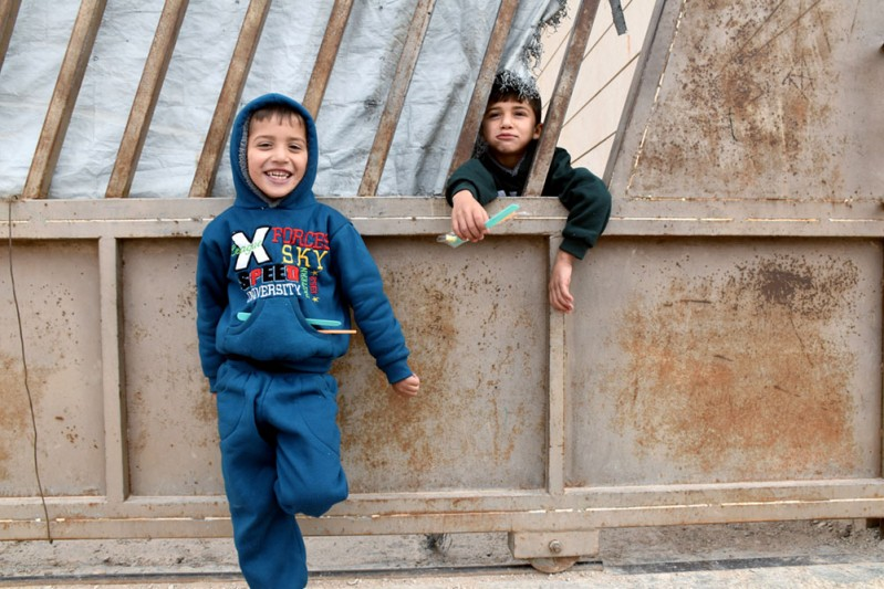2. Twins Elias (left) and Abdullah (right), 5, outside their home_min