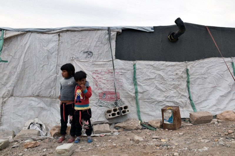 7. Sisters Sabeen, 5, (left) and Haya, 3, (right) live in a makeshift shelter