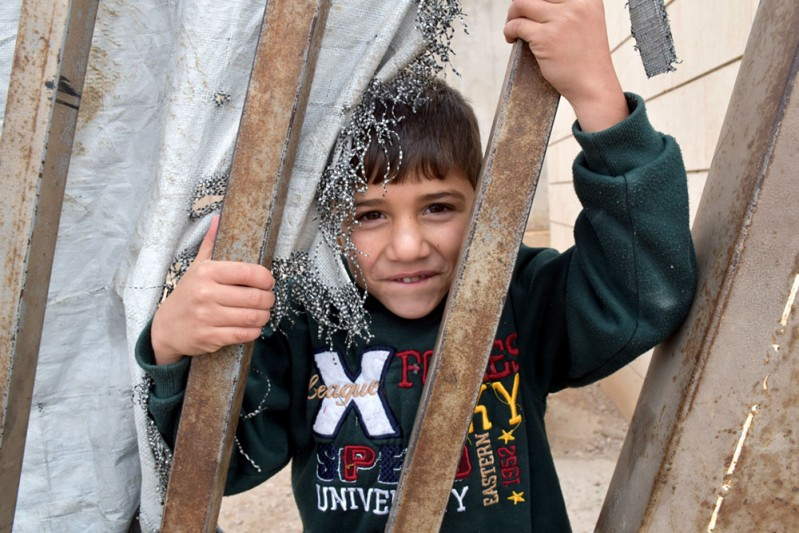 1. Abdullah, 5, behind the bars_min